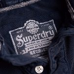 Polo Superdry homme modèle Vintage Destroyed Sleeve bleu ink