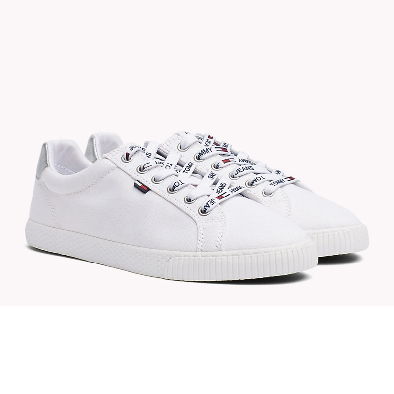 courir chaussures vente discount mieux choisir Chaussures en toile blanche Tommy Hilfiger Jeans femme